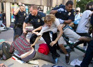 OccupySD protesters being arrested for refusing to take down tents at the San Diego Civic Center (AP Photo/ Gregory Bull)